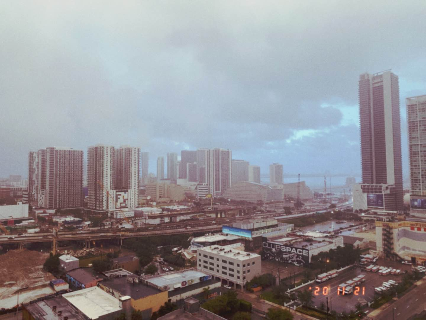 Miami, FL during rainshower. Skyscrapers to the right.